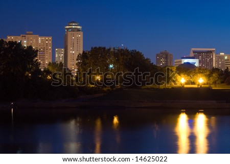 A view of a Winnipeg skyline from across a river at night