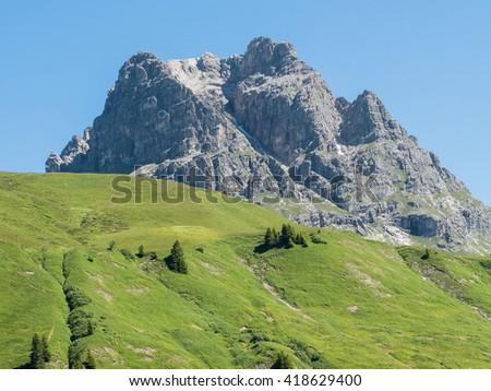 A view of Alpine mountains surrounding the village Schroecken in Bregenzerwald, region Vorarlberg, Austria - stock photo