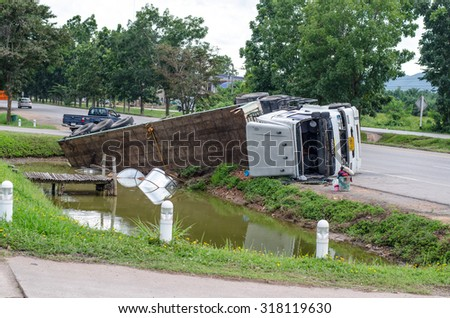 A view of an overturned truck on an highway in an accident.,Thailand on 31 August 2015