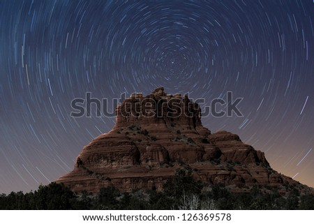 A view of Bell Rock at night with stars rotating - stock photo