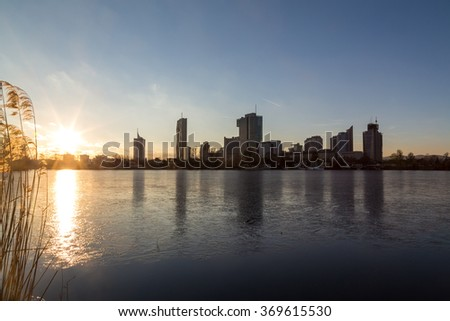 A view of buildings in the Donaucity in Vienna. Taken in the winter at sunset. - stock photo