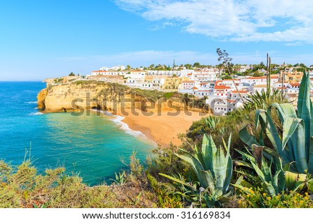 A view of Carvoeiro fishing village with beautiful beach, Portugal - stock photo