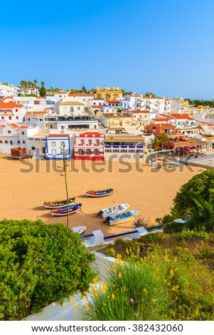 A view of Carvoeiro fishing village with colourful houses on beach, Algarve, Portugal - stock photo