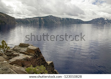A view of crater lake with cloudly sky - stock photo