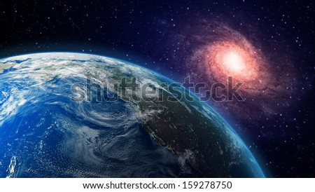 A view of Earth and a spiral galaxy in the background - stock photo