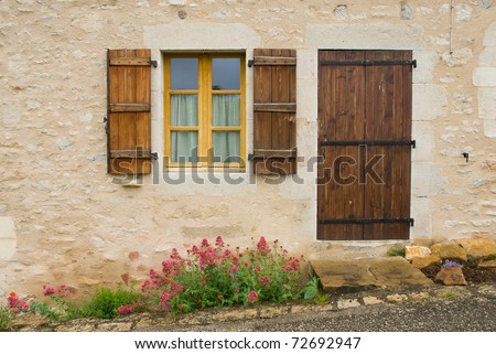 A view of french village, door,window and flower.