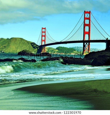 A view of Golden Gate Bridge from Baker Beach in San Francisco, United States, with a retro effect - stock photo