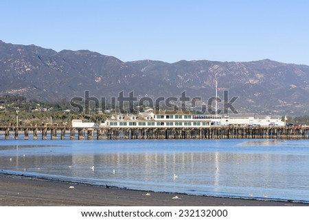 A view of historic Stearns Wharf framed against the mountains of Santa Barbara, California.