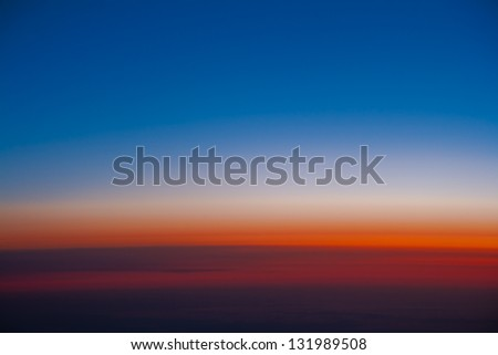 A view of horizon during sunrise from air plane - stock photo