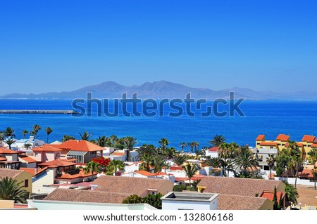 a view of Lobos Island from Corralejo in Fuerteventura, Canary Islands, Spain - stock photo