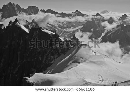 A view of Mont Blanc mountain range from Aiguille Du Midi in Chamonix - landscape orientation - stock photo