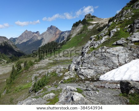 A view of Mount Larrabee, American Border Peak and Canadian Border Peak from the rocky trail of Yellow Aster Butte - stock photo