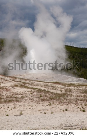 A view of Old Faithful geyser in Yellowstone National Park. - stock photo