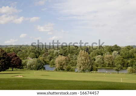 A view of parkland in summerwith a cloudy sky