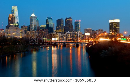 A view of Philadelphia; Pennsylvania�s cityscape overlooking the Schuylkill River at night.  HDR from three exposures. - stock photo
