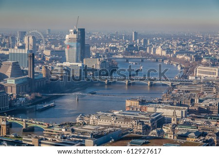 a view of river Thames in London on a sunny day with visible smog, air pollution