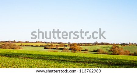 A view of rolling farmland in Suffolk, UK with copyspace - stock photo