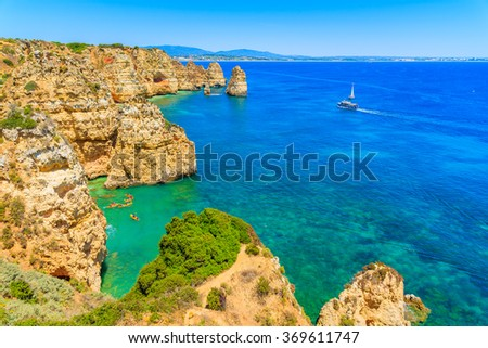 A view of sea bay with kayaks and boats on turquoise water at Ponta da Piedade, Algarve region, Portugal