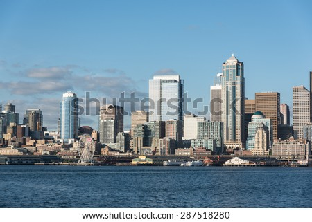 A view of Seattle downtown, Business district, Space Needle and blue ocean under a clear blue sky from Alki beach - stock photo
