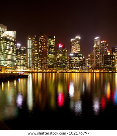 A view of Singapore business district, with water reflections.