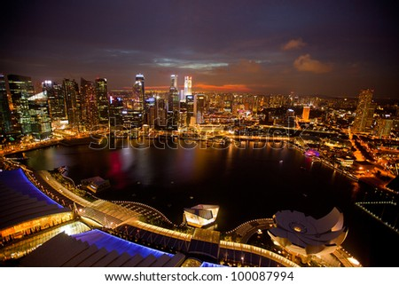 A view of Singapore from roof Marina Bay hotel, in the night time - stock photo