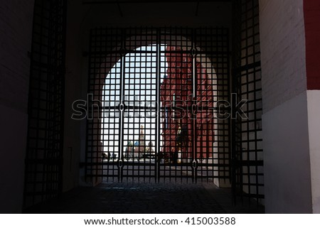 A view of St. Basil's Cathedral through the arch of Resurrection gate - stock photo