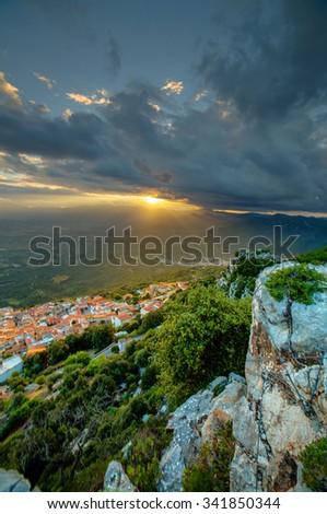 A view of sunset over Baunei, Sardinia - stock photo