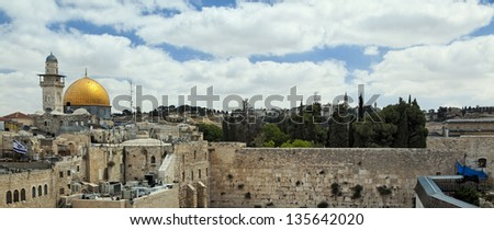 A view of Temple Mount in Jerusalem, including the Western Wall and golden Dome of the Rock. - stock photo