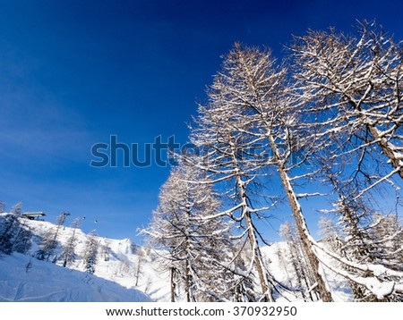 A view of the Alpine landscape in the winter season in Nassfeld - stock photo