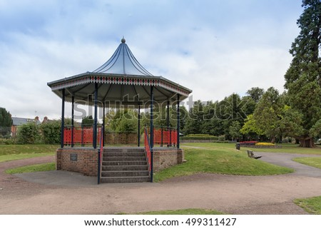 A view of the bandstand in the public gardens at Alton town park in Hampshire.