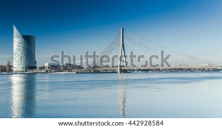 A view of the buildings and Vansu bridge on the banks of the Daugava River in Riga, Latvia - stock photo