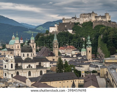 A view of the city and the hill fort Hohensalzburg above it in Salzburg - stock photo