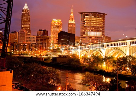 A view of the Cleveland skyline at night - stock photo