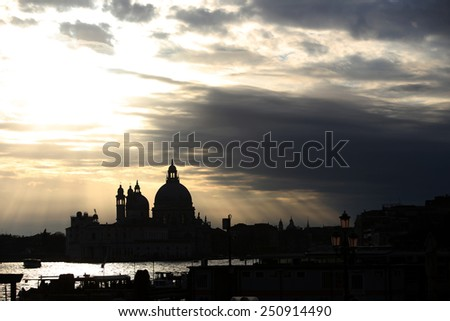 A view of the cloudscape over the Santa Maria della Salute church at sunset in Venice,Italy. - stock photo