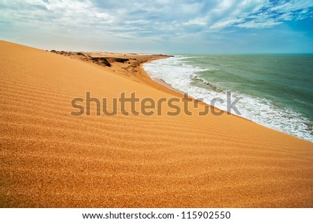 A view of the coastline as seen from the Taroa sand dune. - stock photo