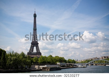 A view of the Eiffel tower from the river Seine. - stock photo
