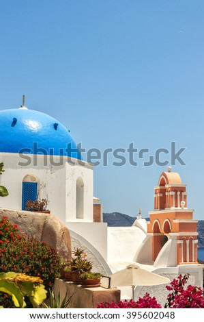 A view of the famous blue domed church from Oia on the greek isle of Santorini. - stock photo