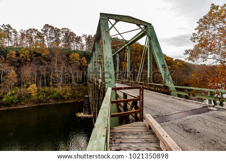 A view of the historic, narrow, one lane green truss Layton Bridge on an autumn afternoon in Fayette County, Pennsylvania.