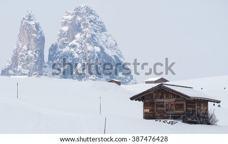 A view of the huts in snow covered landscape in the mountains