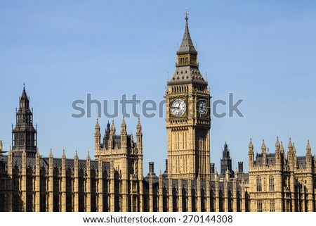A view of the iconic clock tower of the Houses odf Parliament in London. - stock photo