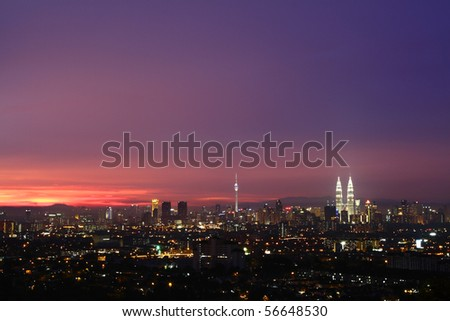 A view of the Kuala Lumpur city skyline at sunset - stock photo