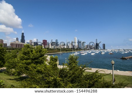 A view of the lake and the buildings  in Chicago - stock photo