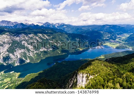 A view of the Lake Bohinj and the surrounding mountains