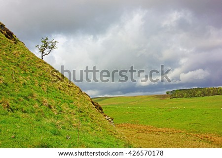 A view of the Northumberland countryside in Spring looking West from Crag Lough, Northumberland National Park, England UK - stock photo