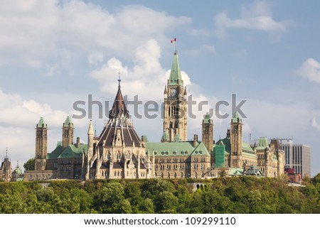 A view of the Parliament buildings in Ottawa, Ontario, including the Peace tower, the round library as well as east and west block. - stock photo