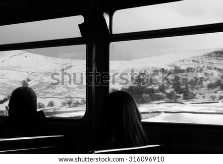 a view of the pennines through the window of a train to sheffield - stock photo