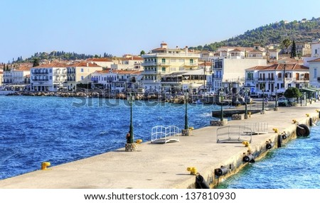 A view of the port of the beautiful Greek Island, Spetses and some of the local architecture. - stock photo