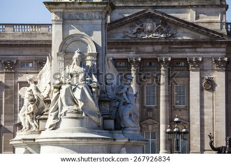 A view of the Queen Victoria Memorial Monument in London with the facade of Buckingham Palace in the background. - stock photo