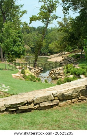 A view of the Reedy River in Falls Park, Greenville, SC. - stock photo