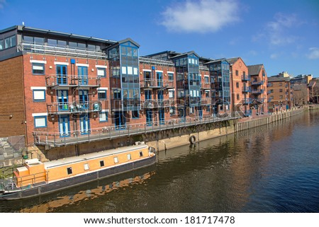 A view of the River Aire, Leeds, Yorkshire, England. An old industrial area renovated with offices, flats and hotels. - stock photo
